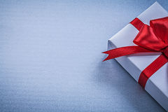 Gift red ribbon on blue background greeting card holidays concep. T Stock Image
