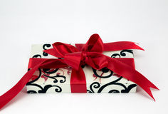 Gift with red ribbon and bow. Gift box with red ribbon and bow Stock Photography