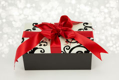 Gift with red ribbon and bow. Gift box with red ribbon and bow Royalty Free Stock Photography