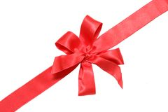 Gift red ribbon and bow. Isolated on white Royalty Free Stock Photos