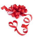 Gift red ribbon and bow isolated on white. Gift red ribbon and bow  and heart isolated on white Stock Image