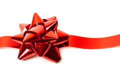 Gift red ribbon and bow isolated on white. Royalty Free Stock Images