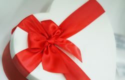Gift with red ribbon and bow stock image