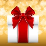 Gift red ribbon bow. White gift with a red ribbon and bow in  format Royalty Free Stock Images