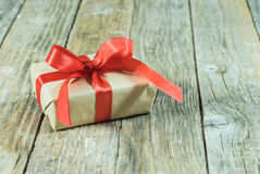 Gift with red ribbon Stock Photos
