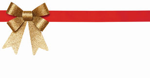 Gift red ribbon and gold bow. Isolated on white Royalty Free Stock Photo
