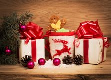 A gift with a red ribbon. Royalty Free Stock Photos