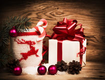 A gift with a red ribbon. Stock Images