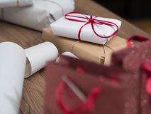 A gift with a red ribbon and several other gifts and bags Royalty Free Stock Images
