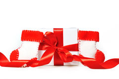 Gift with red ribbons Stock Images