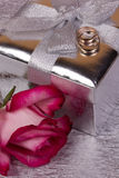 Gift and red rose Stock Photos
