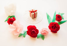 Gift, Red and rose paper flowers. Gift and red and rose paper flowers on white background. Cut from paper. Place for your text Stock Images