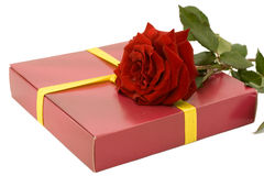 Gift and red roses Stock Images