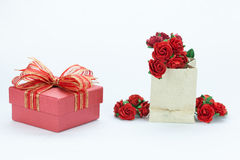 Gift and red roses on white isolated background Royalty Free Stock Image