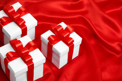Gift on red satin background Royalty Free Stock Image