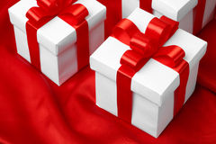Gift on red satin background Royalty Free Stock Images