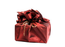 Gift in red silk cover Royalty Free Stock Photography