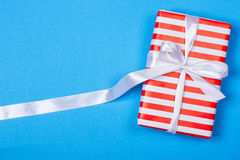 Gift in red and white packing with ribbon Royalty Free Stock Photo
