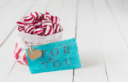 Gift of red and white striped candy Stock Photography