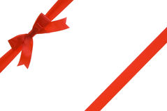 Gift ribbon. Red ribbon with red bow on gift Stock Photography