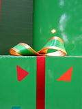Gift & ribbon. A gift in green with  ribbon Stock Photography