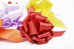 Gift ribbon bows of different colors. Closeup of some satin gift ribbon bows of different colors on a white background Stock Image