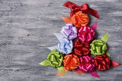 Gift ribbon bows forming a christmas tree Stock Image