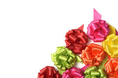 Gift ribbon bows. Some satin gift ribbon bows of different colors on a white background, with a negative space Royalty Free Stock Photo