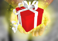 Gift. Ribbon hands stars offer red glow Royalty Free Stock Images