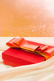 Gift. With ribbon in shiny background Stock Photo