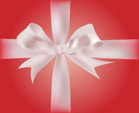 Gift with ribbons. With gradient red wrapping paper Stock Photos