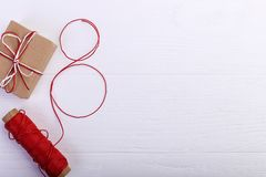 A gift and a rope with a figure eight thread. Women`s day concept, banner, copy space, blank stock image
