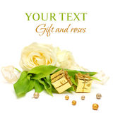 Gift, rose flowers and gold ribbon Royalty Free Stock Image
