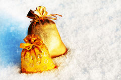 Gift sacks on a white snow Stock Photo
