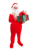 Gift For Santa Claus. Santa Claus in his pajamas, surprised by a Christmas gift for him. Full body isolated royalty free stock images