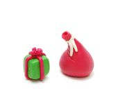 Gift and Santa's Sack. 3D Christmas Gift and Red Santa's Sack Made of Plasticine Isolated on White Background Stock Photo