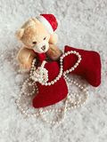 A gift from Santa to Christmas. A gift from Santa Clause..A soft bear toy on the snow background Stock Photo