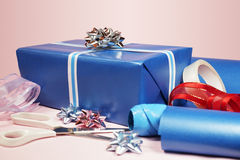Gift With Scissors, Tape And Ribbons Royalty Free Stock Image