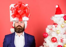 Gift service. Head downtrodden with thoughts what to gift. Man bearded formal suit carry gift box on head. Christmas. Present idea concept. Thinking about gift royalty free stock photo