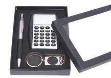 Gift set. Gift set, a calculator, a pen, pendant, in a black box Royalty Free Stock Photos