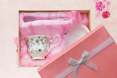 Gift set of cup, plate and spoon in open box isolated Stock Photos
