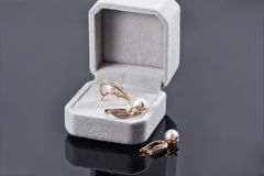 Gift set of gold jewelry with pearls Stock Image