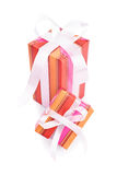 Gift set. Two gifts wrapped in colorful paper with white ribbons isolated on white background Stock Photos