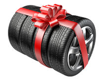 Gift set tyres with a wrapped red ribbon and bow. Royalty Free Stock Image