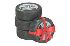 Gift set of wheels wrapped ribbon and bow, 3D rendering. White background Stock Photo