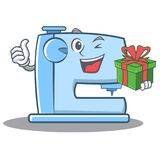 With gift sewing machine emoticon character Stock Photo