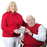 Gift-Sharing Seniors Stock Photography