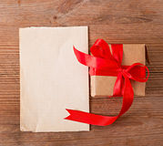 Gift and a sheet of paper Stock Photography