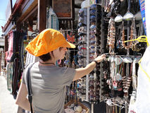 In the gift shop. Young woman shopping for souvenirs, Rhodes, Greece stock images