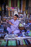Gift Shop Ajmer Rajasthan India. Man pouring perfume into a bottle in a market gift shop. Ajmer, Rajasthan, India royalty free stock photography
